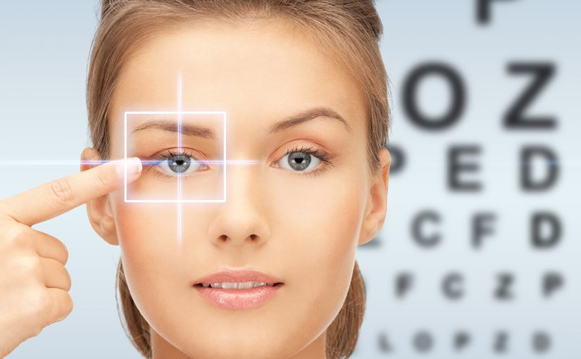 LASIK patient in front of eye test background.